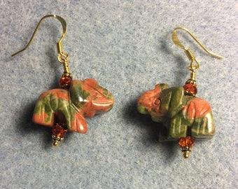 Orange and green unakite gemstone elephant bead earrings adorned with orange Chinese crystal beads.