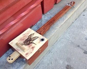 Cigar Box guitar: Wooden box / Woodburning / Piezo and jack