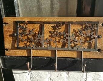 Reclaimed metal coat hook on victorian oak board