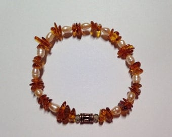 The Calmer. Baltic Amber , fresh water pearls bracelet.