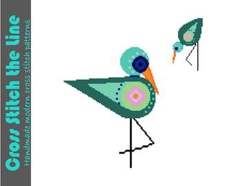 Gorgeous folk Boho cross stitch pattern of wading birds. Modern cross stitch. Contemporary design.