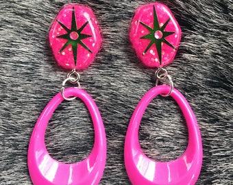 Pink and green starburst glitter resin dangle earrings