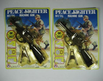 Free WW Shipping. Two (2) BRAND NEW Vintage 1970's Timmy Toys Peace Fighter Metal Machine Guns. 8 Shot Caps Guns.Nice Details Limited Stock