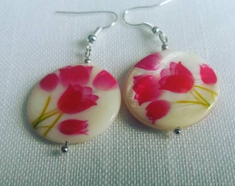 Pearl earrings with bright pink tulips.