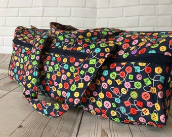 Medium knitting bag with button design.