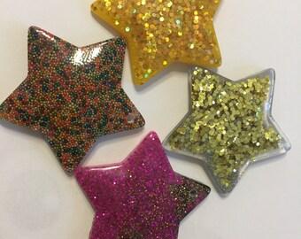 Lot 4 star pendants