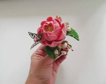 Pink knitted rose brooch