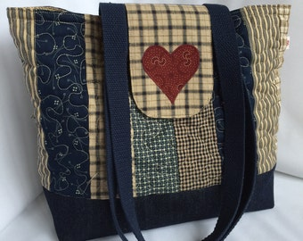 Blue patchwork quilted tote bag with appliqué heart design