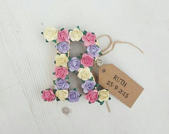 Floral letter with personalised tag