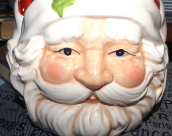 Vintage, large Santa Claus cookie jar made by SAKSCO Gourmet.  Cheerful Mr. Claus in red cap with stars and holly abounding!