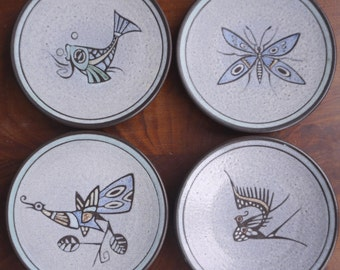 Four vintage most beautiful drawn phantasy animal - insect plates, mid century design, unknown maker. Fish, dragonfly, birds: peacock, crane