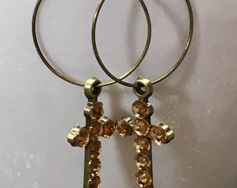 Hoop earrings with rhinestone crosses