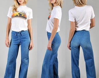 Vintage 1970's high-waisted denim bell-bottoms with extra wide flare       A4