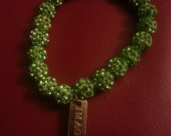 Green Rhinestone Bracelet with Imagine Charm.