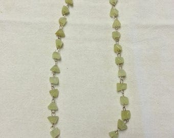 Vintage, green peridot triangular shaped beads and gold tone metal necklace, 1960
