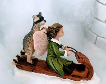 Miniature Fairy and Raccoon on a Toboggan