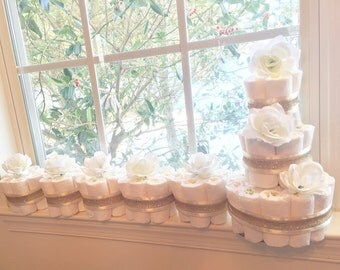 Diaper cakes with gold ribbon and white roses. Baby shower decorations/centerpieces. 1 3-tier diaper cake and 5 1-tier centerpiece