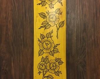 Gold rose skateboard art