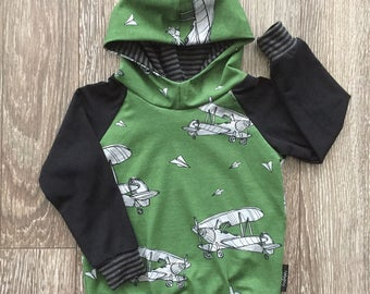 Quantity limit sweater hooded for baby and child, on grounds of aircraft on a green background, black sleeves