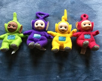 Set of four beenie plushy vintage teletubbies approx 6 inches tall dated 1996