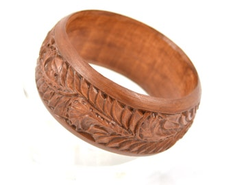 Carved wooden bangle bracelet. Wood carving