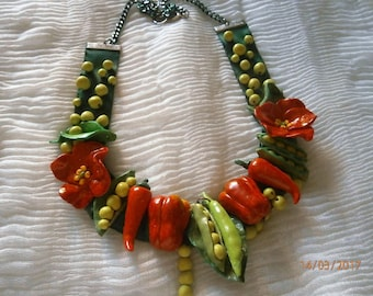 PP peas and peppers in polymer clay mounted on grosgrain Ribbon in shades of red and green