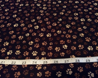 Timeless Treasure dog cat paw print  fabric, browns sold  by the half yard