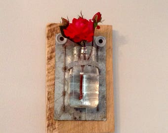 Reclaimed wooden plaque with hanging flower jar