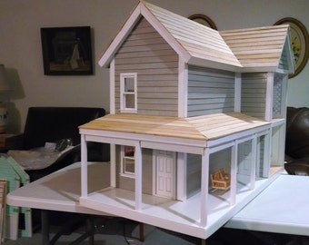 All wooden doll house built by Almost Real Houses in Michigan
