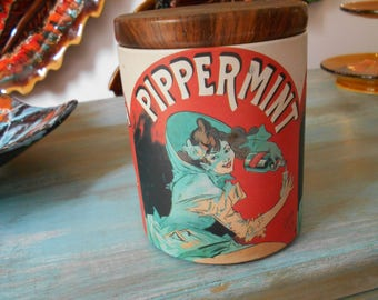 """Vintage French 'Pippermint' Advertising Tin with illustrations by Jules Chéret, stamped """"Massily France""""."""