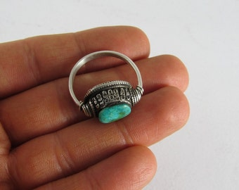 Tibetan silver ring with antique turquoise bead