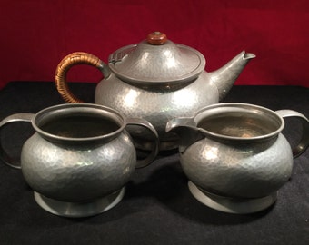 Tudric Pewter Ware Tea Set - (Teapot, Milk Jug, Sugar Bowl) - Attributed To Archibold Knox - (Sold By Liberty of London)
