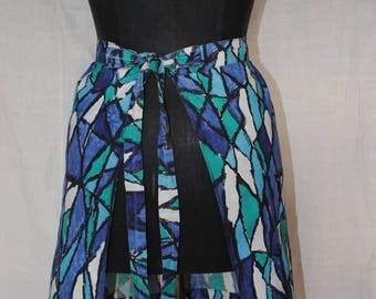 Blue, white and green apron 1950