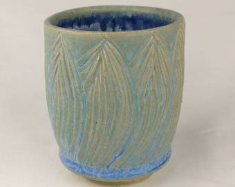 Carved Yunomi (teacup) in greens, blues and yellow