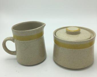 Vintage japan stoneware creamer and sugar bowl. Bonus creamer!