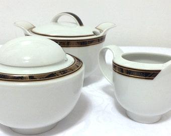 3 Vintage Hutschenreuther (Rosenthal) Galleria shape, Leonard motif, white porcelain, creamer, sugar bowl, gravy bowl, gold & black