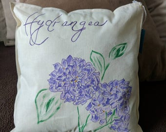 Hydrangea throw pillow. Beautiful botanical design features purple hydrangea and elegant lettering