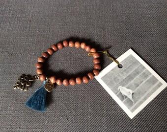 Bracelet made of wooden bead blue tassel Pom brass heart Ibiza hippy tassel