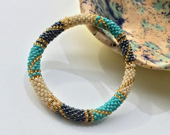 Nepal roll on Bangle Bracelet. Beaded Bracelet Handmade by Ramila Beads, Blue, White and Gold Hippie Bracelets.