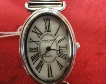 Ladies designer watch by CONSTANT oval shape with roman nbrs ,  GREAT OFFER!