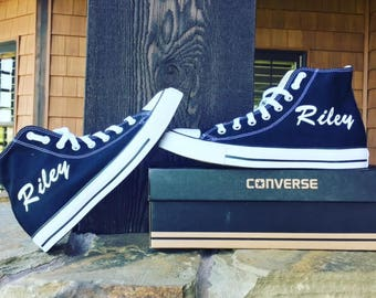 Custom high-top Converse Chuck Taylor sneakers