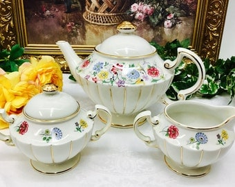 Elgreave china teapot with cream and sugar.