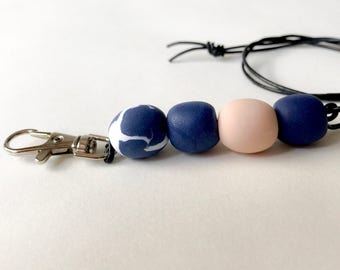 Beaded navy, pink and white lanyard