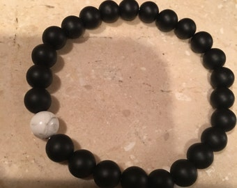 Single black matt bracelet with howlite stone