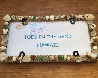 Beach glass with coral & shells . All license plate frames are made with a combination of beach glass, shells. For rear license plate frame