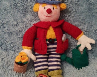 Hand-knitted Gardening Clown, complete with knitted accessories, made using a Jean Greenhowe pattern.