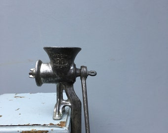 Vintage meat mincer with wooden handle