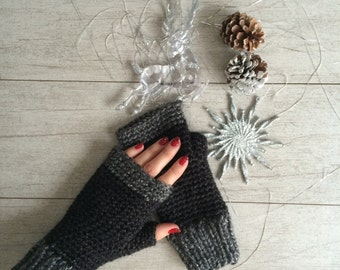 Black fingerless crochet gloves, knitwear,  stocking stuffers, chunky knits, wrist warmers, arm warmers, hand warmers, crochet gloves.