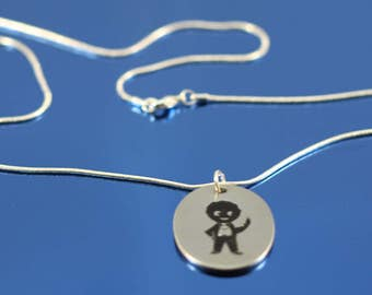 1970s Robertson's golly promotional pendant necklace.