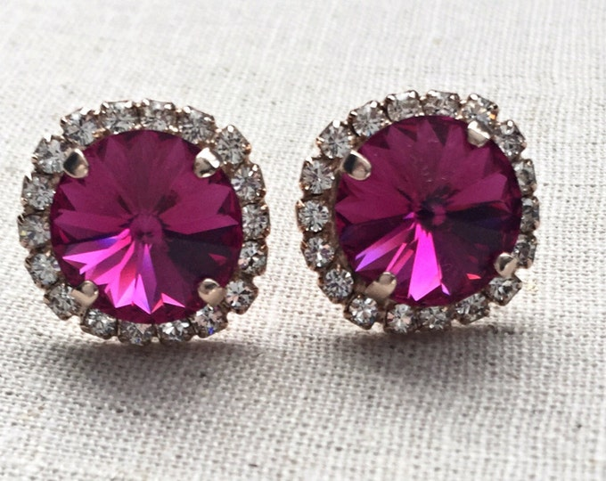 Genuine Swarovski crystal Fuchsia Classic Stud Earrings with a halo of pave stones. Swarovski pink earrings